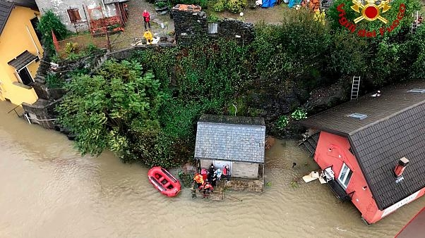 At least four people have been killed in flooding in a mountainous border region of France and Italy,