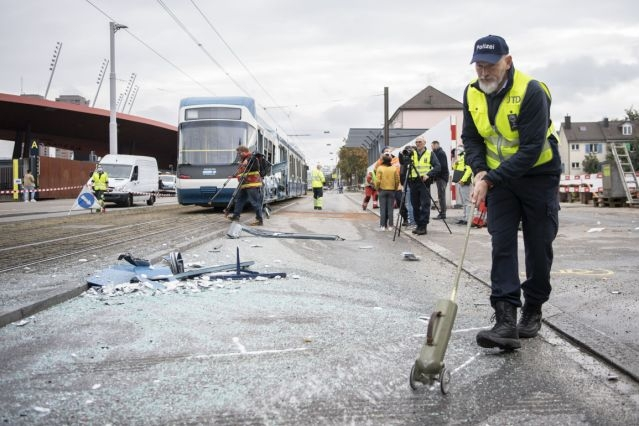 Fourteen people have been injured after a truck collided with a tram in the Swiss city of Zurich.