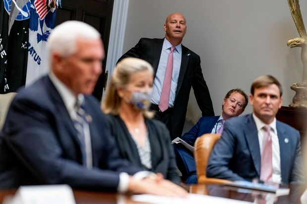 Vice President Mike Pence's chief of staff Marc Short, pictured center in September, has tested positive for Covid-19.