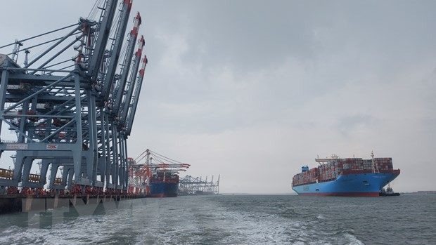 Super large container ship Margrethe Maersk prepares to dock at Cai Mep International Terminal.  (Photo: VNA)