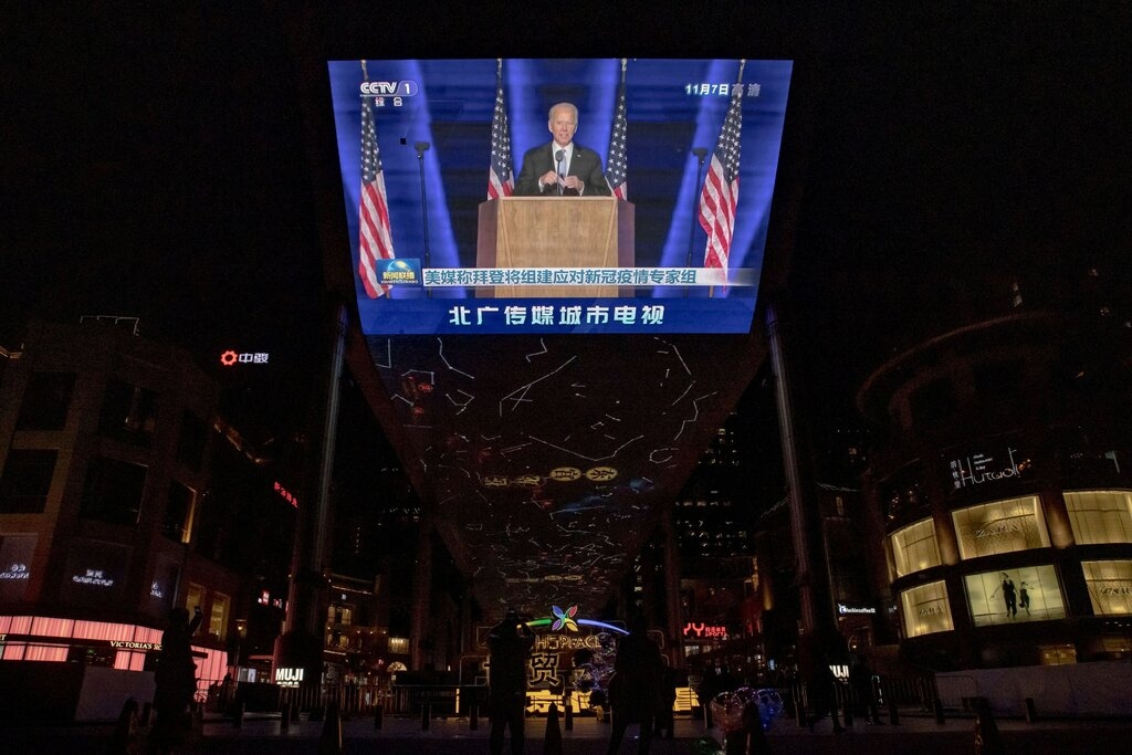 A state media broadcast in Beijing on Sunday showing President-elect Joseph R. Biden Jr. delivering his victory speech.Credit...