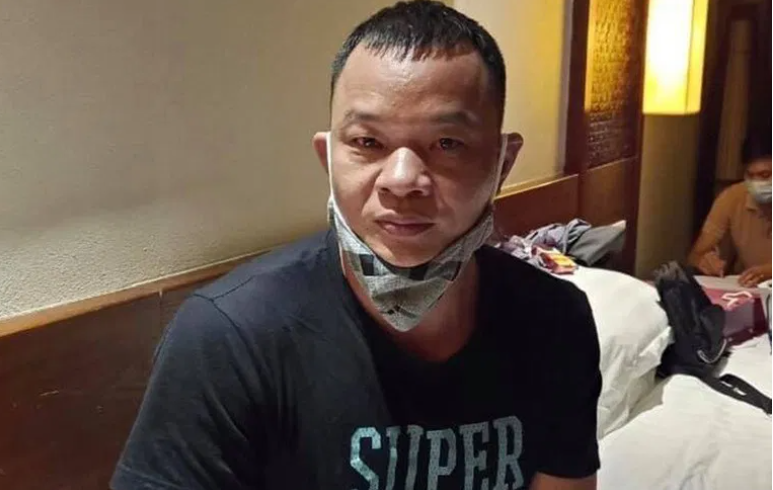 Gao Liang Gu, the Chinese national arrested for illegally bringing foreigners to Vietnam ( Photo courtesy of Public Security Newspaper)