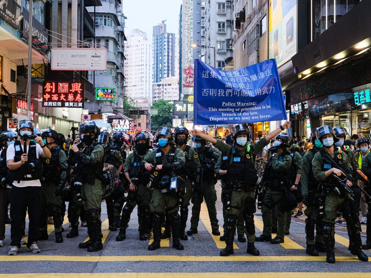 China will be charging 12 people from Hong Kong who were caught trying to flee the city in a speedboat (Photo: Guardian)