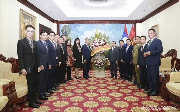 The delegation led by  Deputy Minister Nguyen Quoc Dung at Lao Embassy in Hanoi (Photo: Bao Quoc Te)