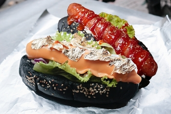 charcoal black bread with gold plated hotdog in hcmc
