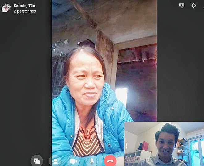 Tan in a video chat with his birth mother (Photo: Thanh Nien)