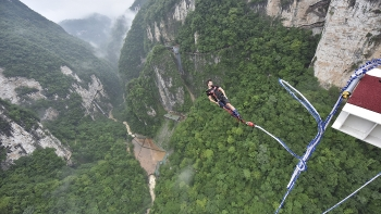 in video thrilling bungee jumping from glass bottom bridge in central china