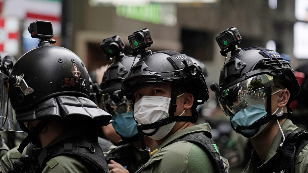 Cameras are installed in the helmets of riot police on China's National Day in Causeway Bay, Hong Kong, on Thursday, Oct. 1, 2020.
