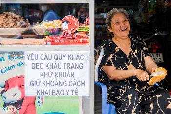 famous 40 year old banh mi ba tau cart vendor in hcmc