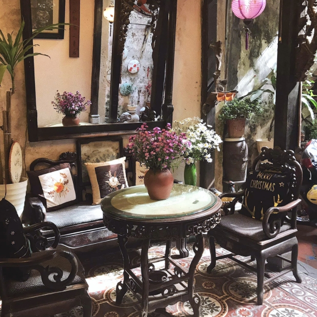 tranquil coffee shop placed in hanois 102 year old house
