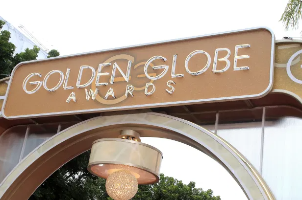 golden globe award to a movie about trial of protest against vietnam war