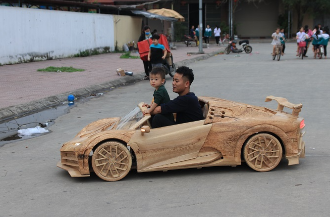 vietnamese father built wooden bugatti centodieci for his son