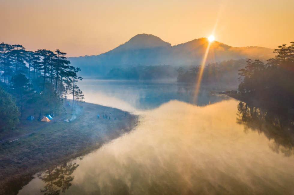 Stunning landscapes of early mist on Tuyen Lam Lake In Da Lat
