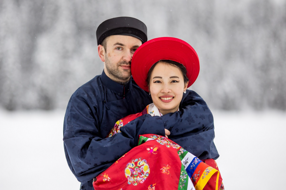 Vietnamese - Polish couple wearing Nguyen Dynasty costume for snowy wedding pictures in Canada