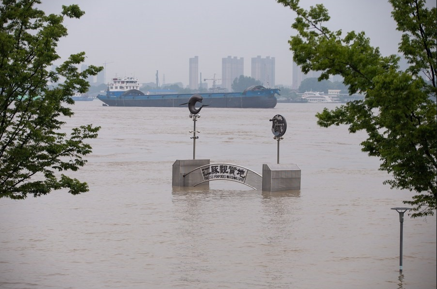 china flood updates thousands trapped after levees fail dams at risk of breaking