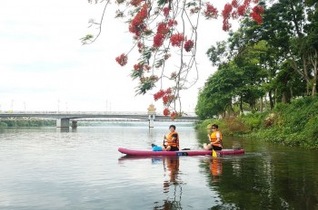 SUP Surfing on Huong River: Admiring Hue from New Angles