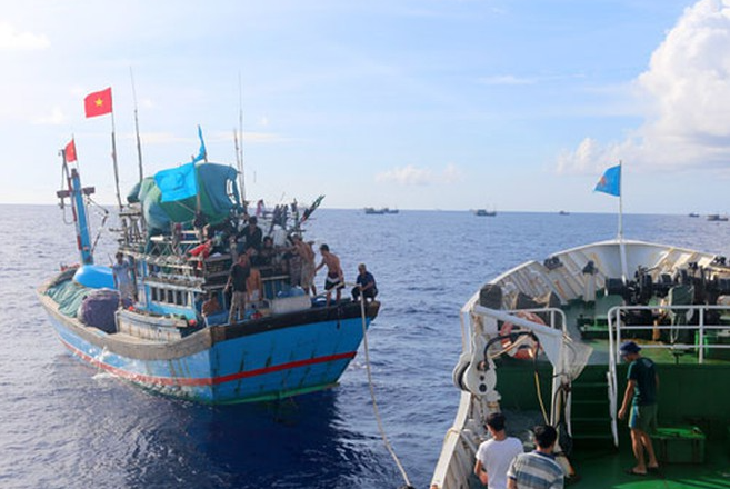a fishing boat and three binh dinh fishermen being rescued