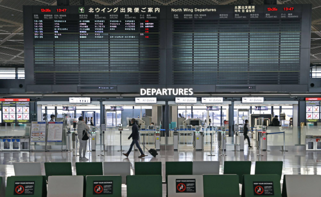 japan to halt new entry of foreign nationals over new virus strain