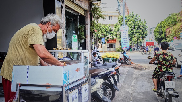 stranded in vietnam french tourist sells street food to earn living during covid 19