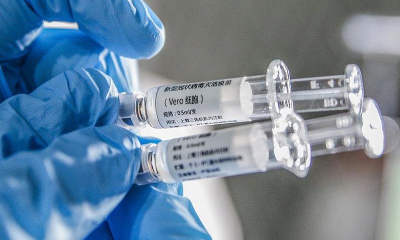 updates on world covid vaccines china approves sinopharm uk authorizes astrazeneca