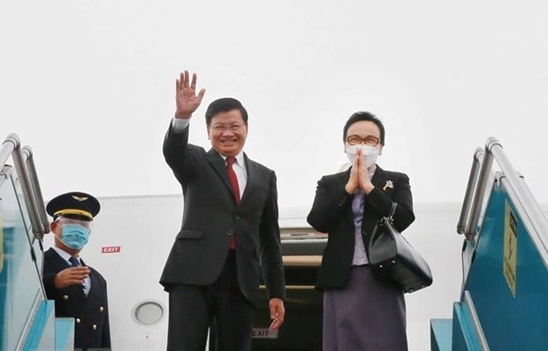 Party General Secretary and President of Laos Thongloun Sisoulith and his spouse. Photo VNA