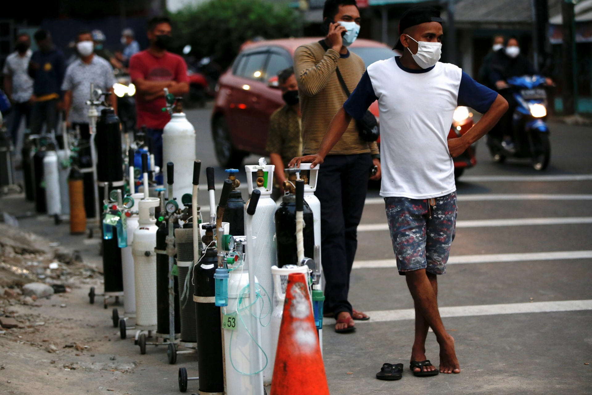People queue to refill oxygen tanks as Indonesia experiences an oxygen supply shortage. Photo Reuters