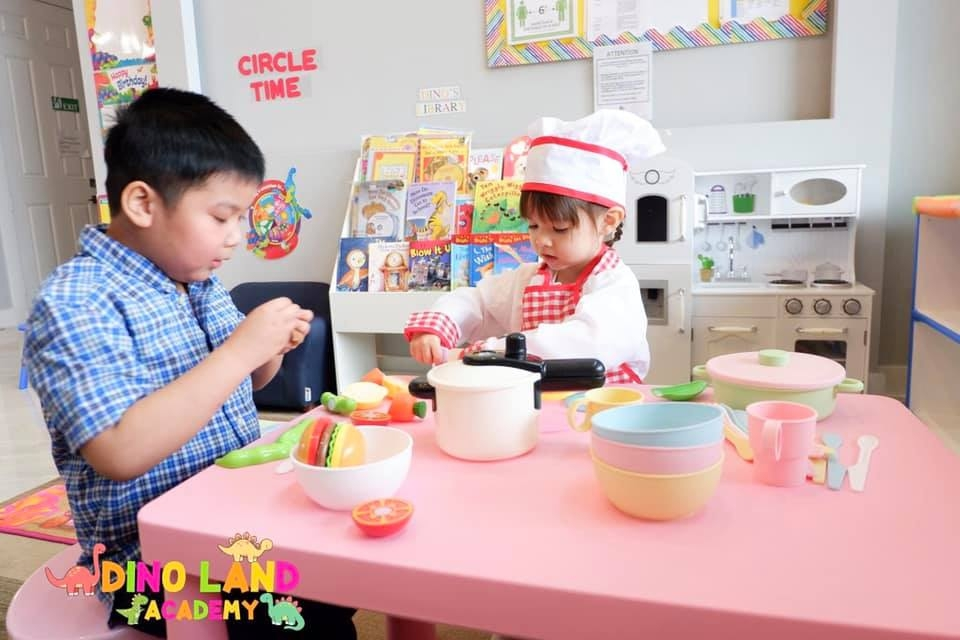 Children at Dino Land Academy role play as chefs. Photo courtesy of the academy