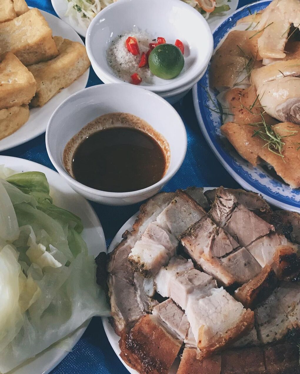 Famous Crispy Pork Roasted on Carrying Poles in Duong Lam Ancient Village