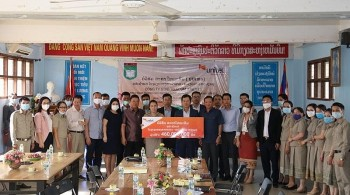 Scholarships and IT Equipment Provided to Vietnamese Lao students