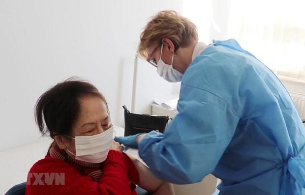 vietnam begins covid 19 vaccinations at vietnam poland medical centre