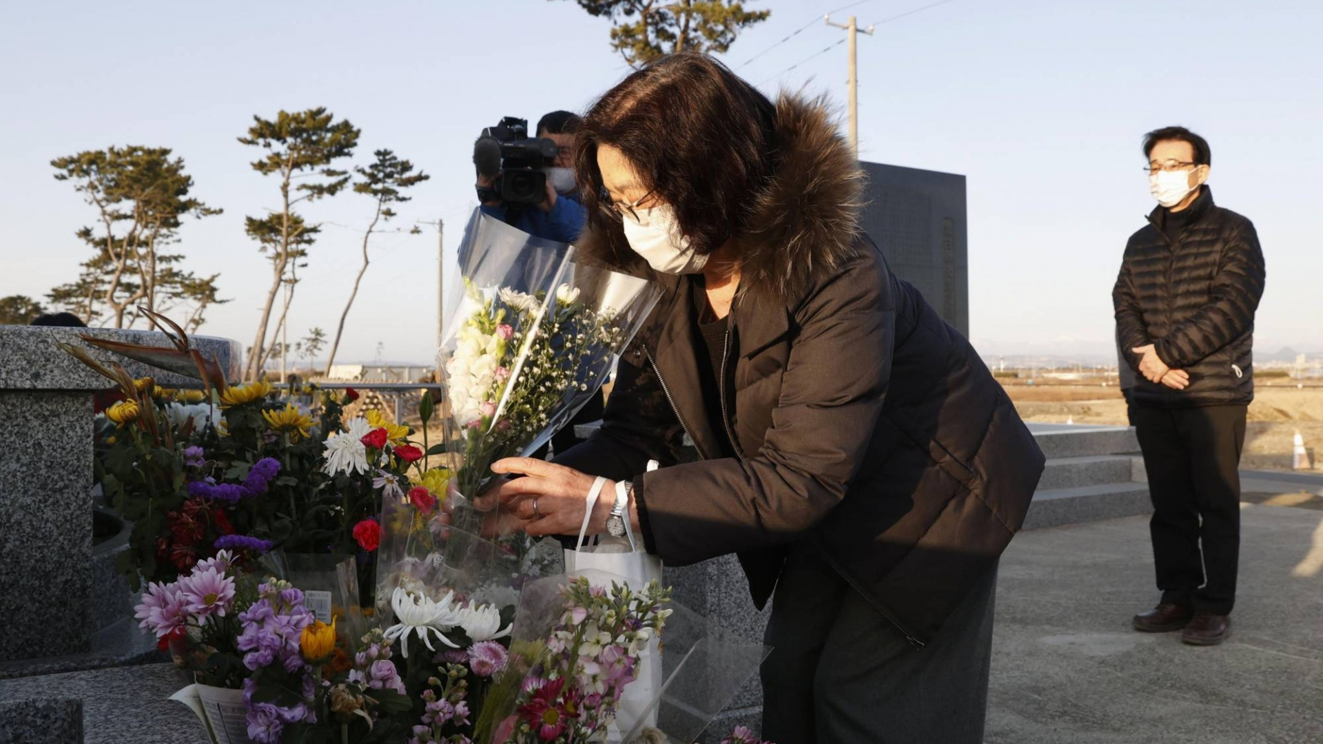 japan mourns lives lost in earthquake and fukushima disaster 10 years ago