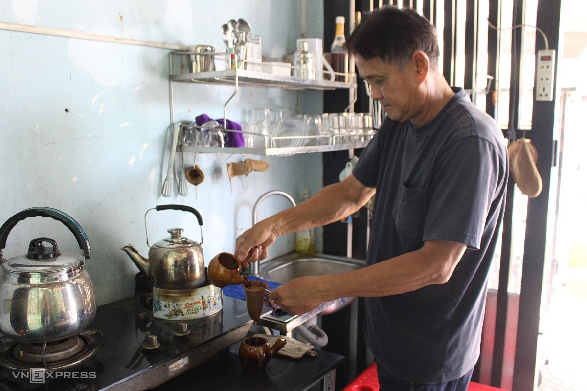 old style racket coffee with ceramic pots in saigon