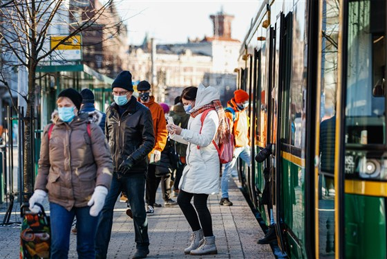 Commuters at a tram stop in Helsinki, Finland, on March 8.Roni Rekomaa / Bloomberg via Getty Images file