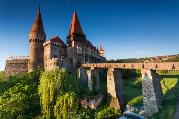 Corvin Castle in Transylvania at dawn (Photo by Walter Bibikow/Getty Images)