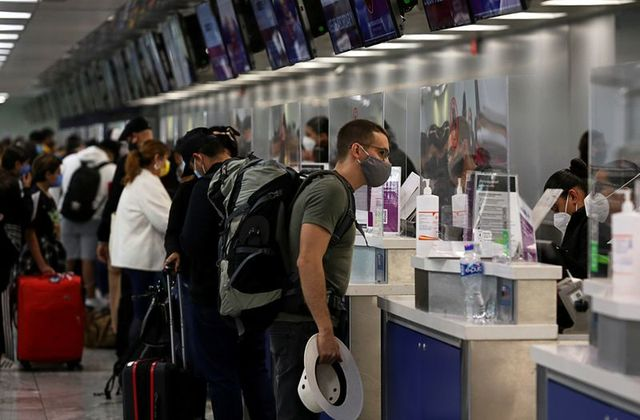 Passengers check-in at airline counters at the Miguel Hidalgo y Costilla International Airport in Guadalajara, Mexico December 9, 2020. REUTERS/Fernando Carranza/File Photo
