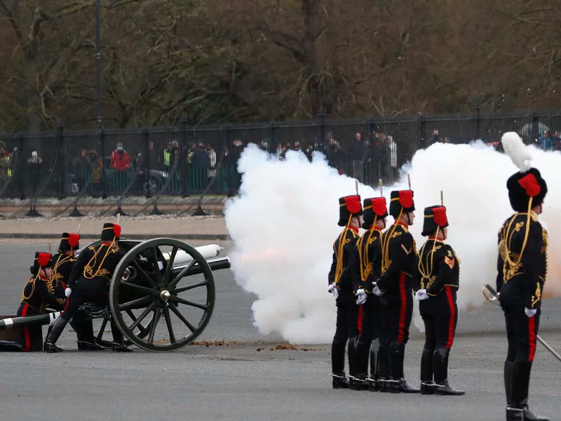Members of the King's Troop Royal Horse Artillery fire a gun salute at Woolwich Barracks on Saturday. The guns used here were also used to mark the wedding Queen Elizabeth II Prince Philip 73 years ago. Alastair Grant/Getty Images
