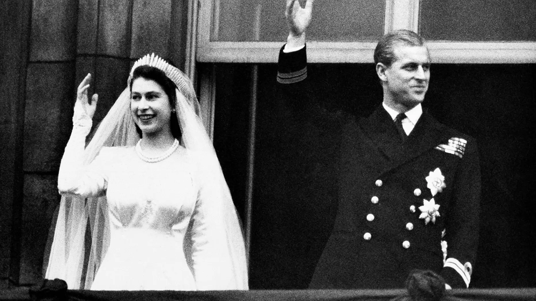 In this Nov. 20, 1947 file photo, Britain's Princess Elizabeth and her husband the Duke of Edinburgh wave to the crowds on their wedding day, from the balcony of Buckingham Palace in London. Buckingham Palace officials say Prince Philip, the husband of Queen Elizabeth II, has died, it was announced on Friday, April 9. (AP)