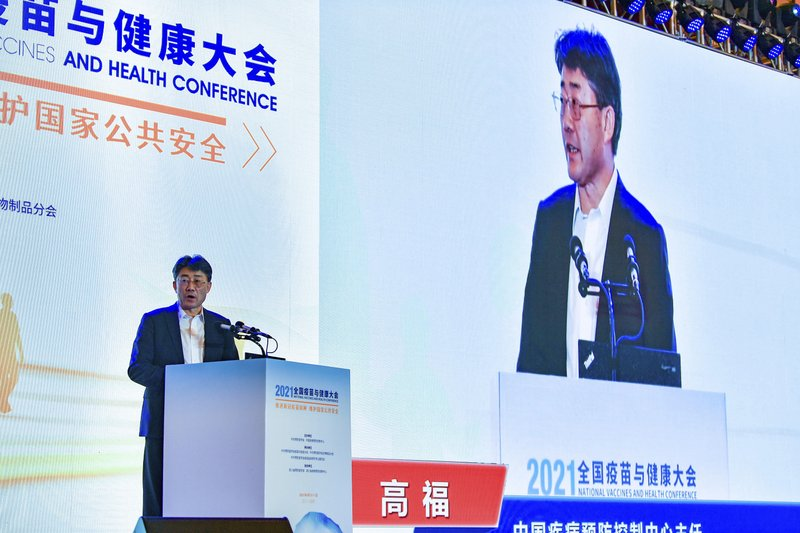 Gao Fu, director of the China Centers for Disease Control, speaks at the National Vaccines and Health conference in Chengdu in southwest China's Sichuan province Saturday, April 10, 2021. In a rare admission of the weakness of Chinese coronavirus vaccines, Gao the country's top disease control official says their effectiveness is low and the government is considering mixing them to give them a boost. (Chinatopix Via AP)