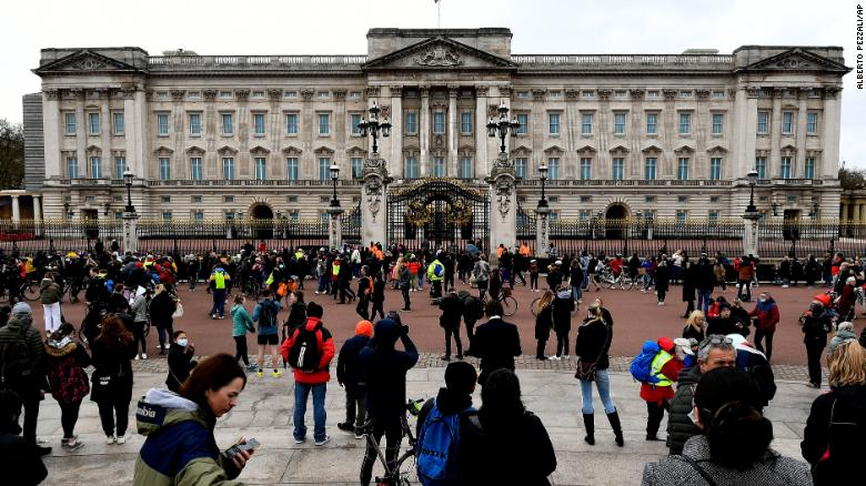 People gather outside the gates of Buckingham Palace in London on Saturday. (Photo: CNN)