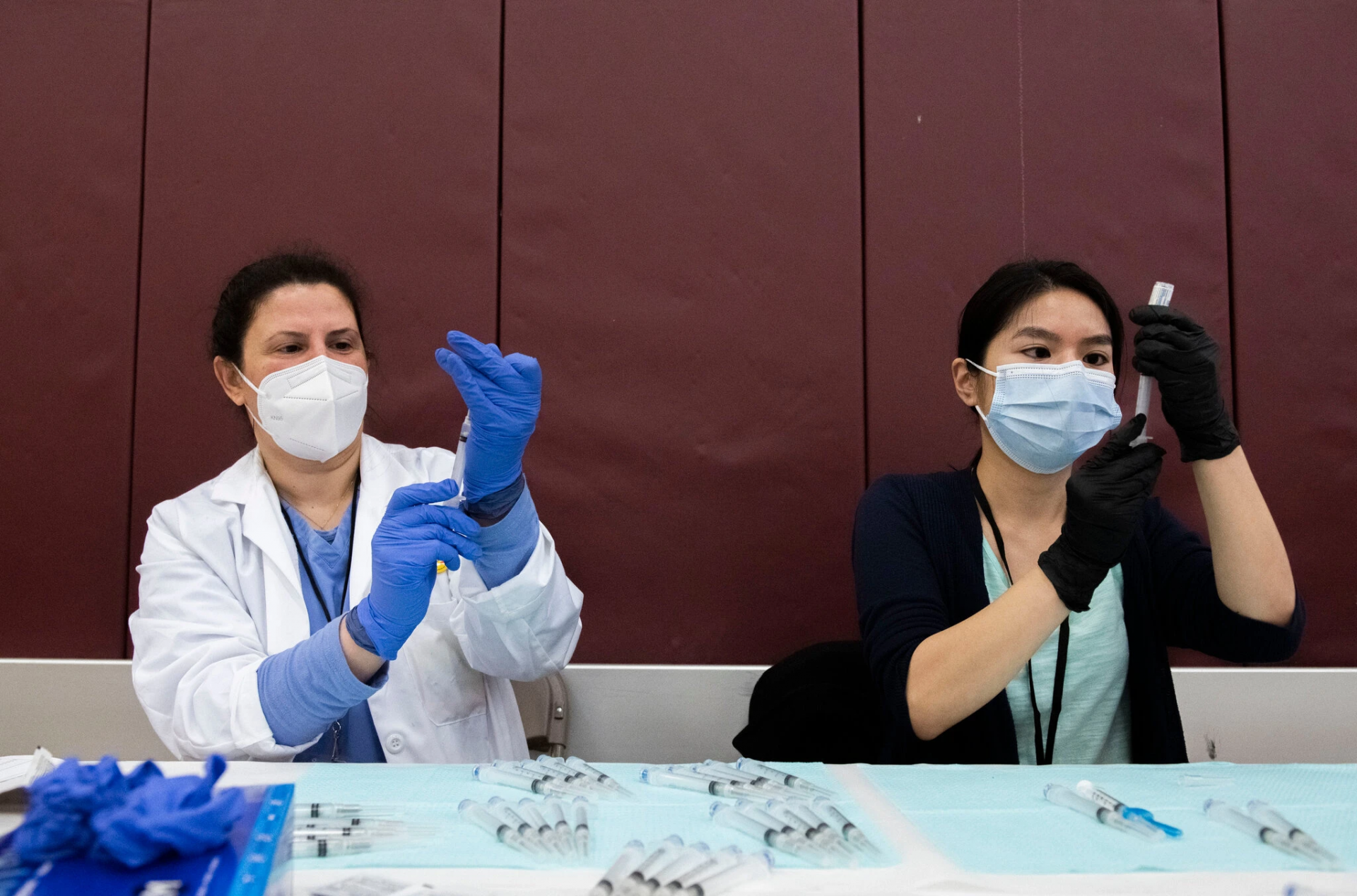 Pharmacists prepared syringes with the Johnson & Johnson vaccine in Detroit on Monday. More than seven million people in the United States have received the vaccine.Credit...Nicole Hester/Ann Arbor News, via Associated Press