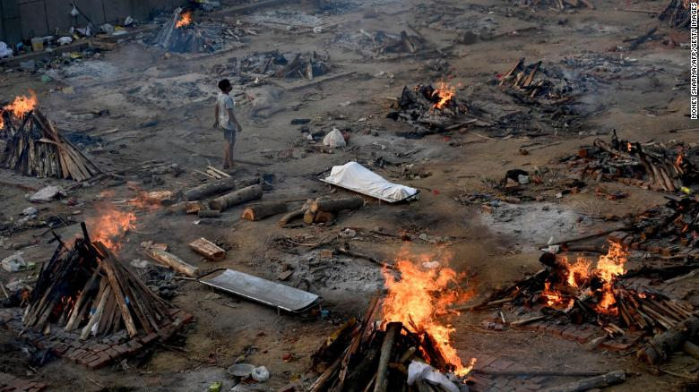 A man stands amid burning pyres of Covid-19 victims at a crematorium in New Delhi, India, on April 26. (Photo: CNN)