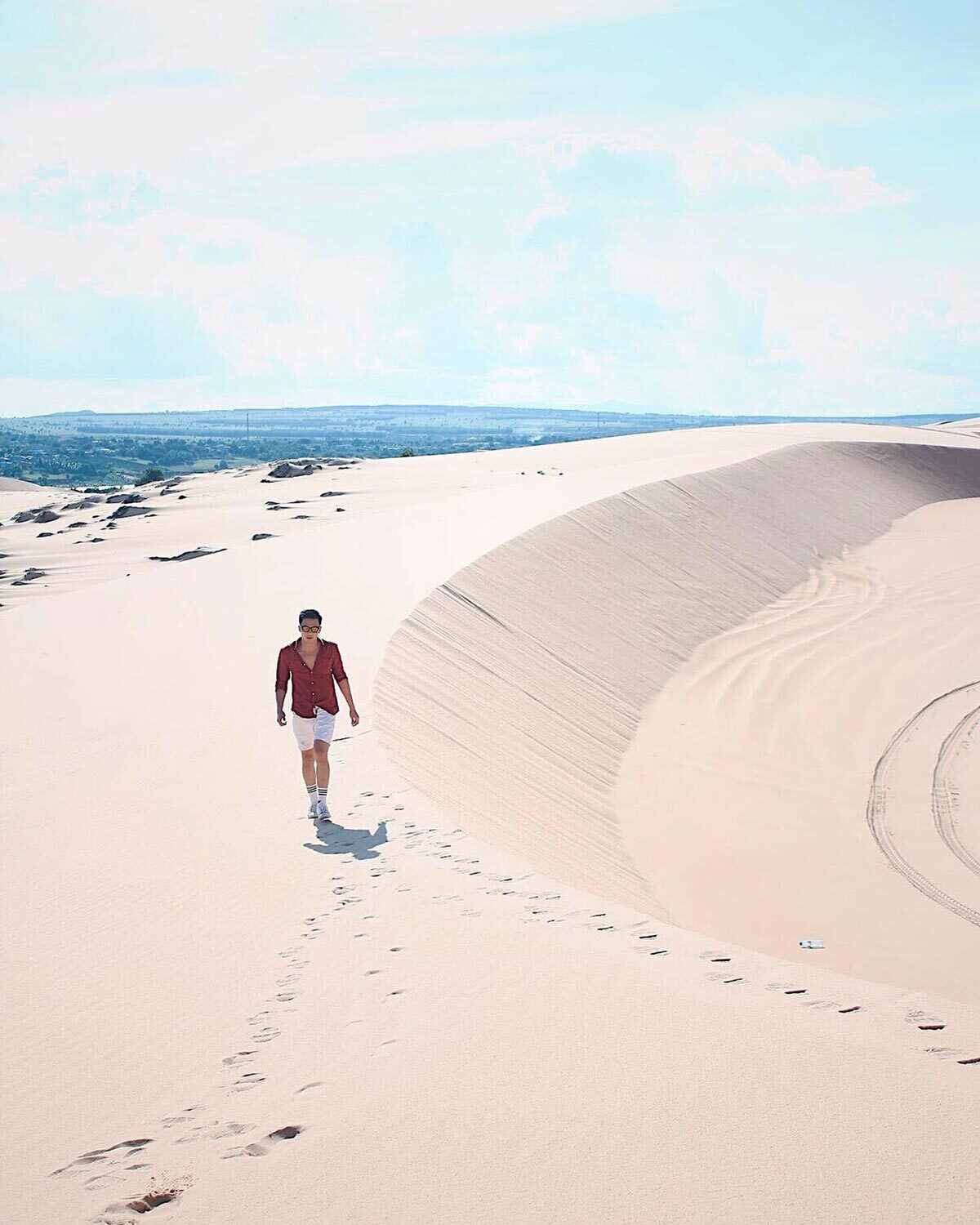 The sand dunes in Bau Trang are shaped by the wind from the sea into a desert-like hill. The tourists can walk on the sand dunes for sightseeing and taking photographs. Photo: Dang Duong