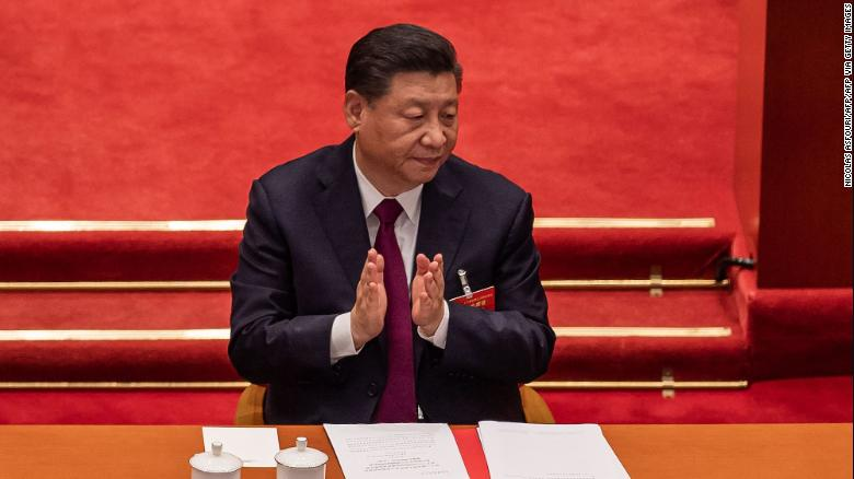 China's President Xi Jinping applauds during the closing session of the National Peoples Congress (NPC) at the Great Hall of the People in Beijing on March 11, 2021. (Photo: CNN)