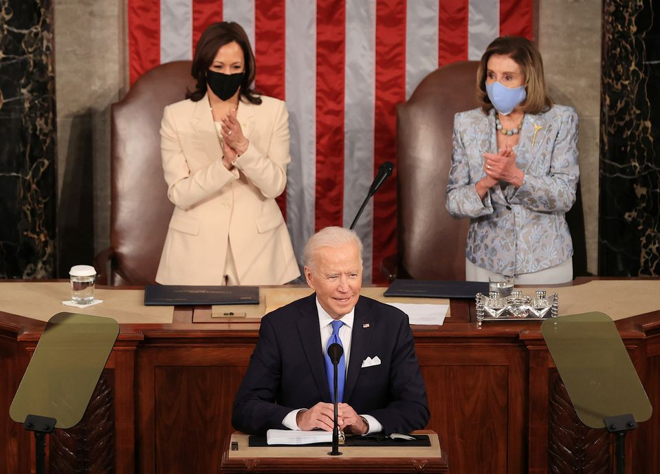 U.S. President Joe Biden addresses a joint session of Congress as President Kamala Harris and Speaker of the House U.S. Rep. Nancy Pelosi (D-CA) react in the U.S. Capitol in Washington, DC, U.S. April 28, 2021. Chip Somodevillaat/Pool via REUTERS