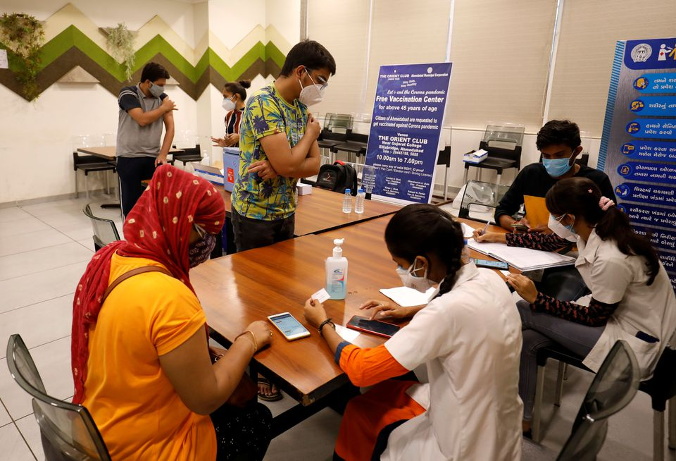 People get their names registered after receiving a dose of COVISHIELD, a coronavirus disease (COVID-19) vaccine manufactured by Serum Institute of India, at a vaccination centre in Ahmedabad, India, May 1, 2021. REUTERS/Amit Dave