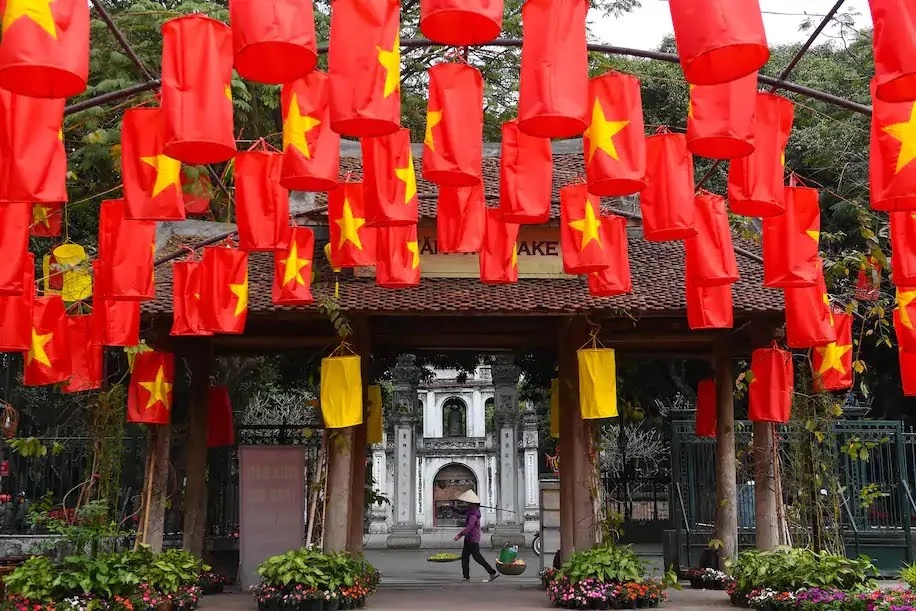 A food vendor walks past the Temple of Literature in Hanoi on Feb. 3. (Nhac Nguyen/AFP/Getty Images)