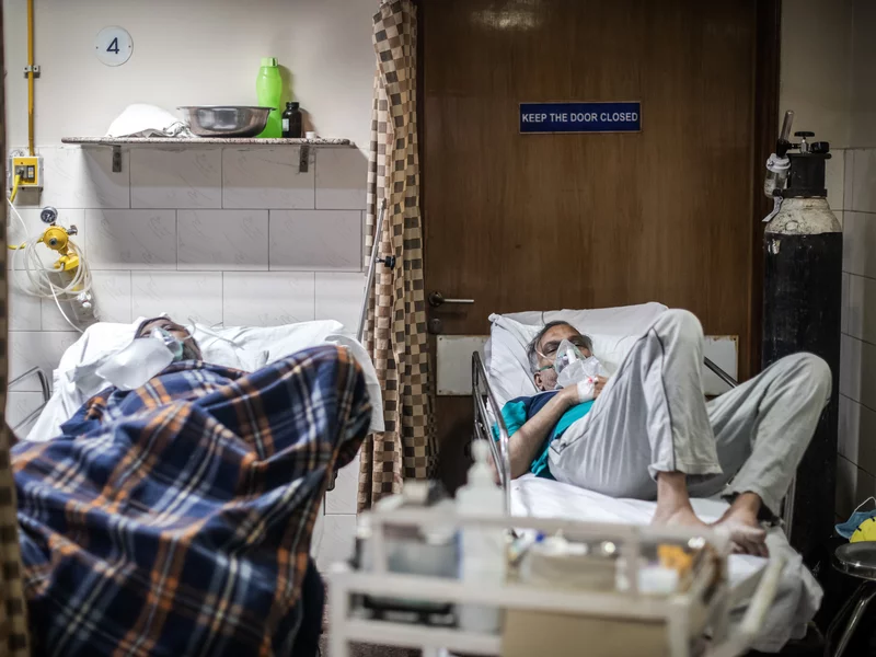 COVID-19 patients in the emergency ward of an unidentified hospital on Monday in New Delhi. Dr. Sumit Ray, a hospital critical care chief in the city, says India's health care system is collapsing. Rebecca Conway/Getty Images