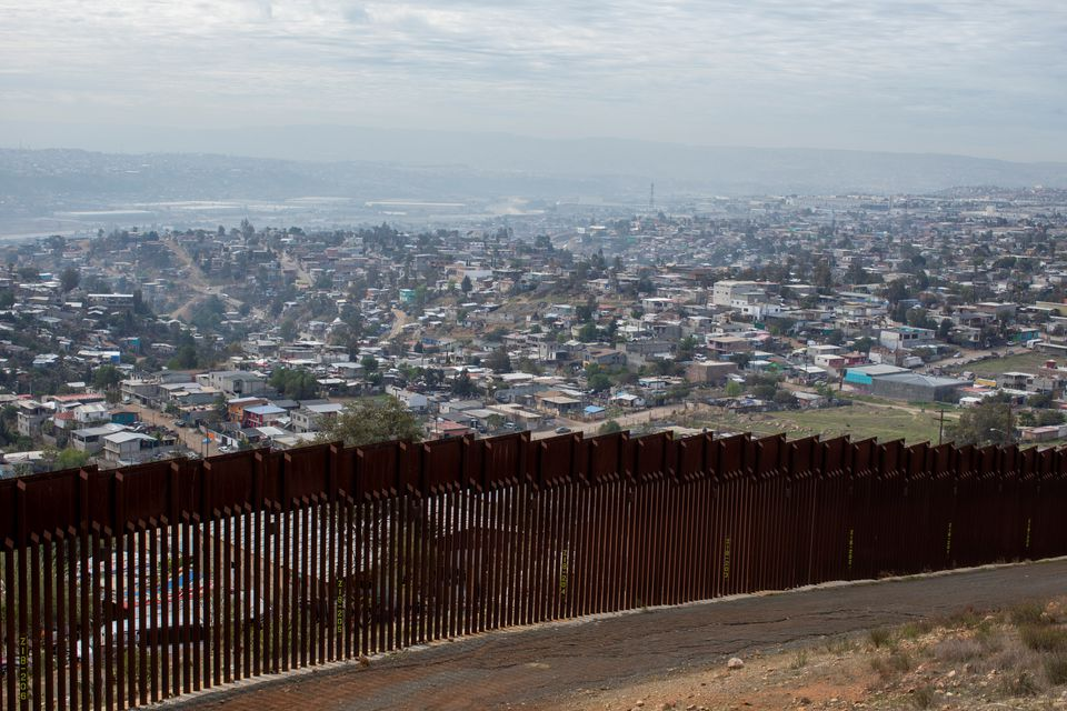 Tijuana, Mexico is pictured behind one of the primary border walls between Mexico and the U.S., east of San Diego, California, U.S., February 2, 2021. REUTERS/Mike Blake