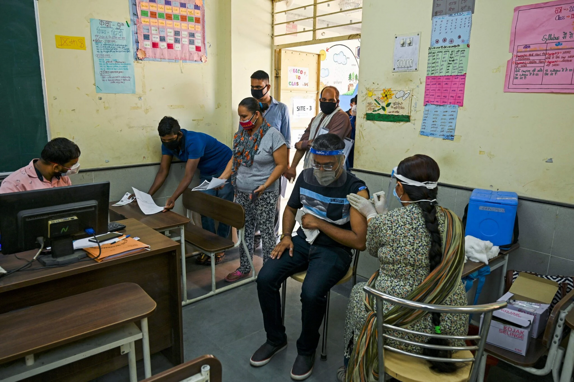 A vaccination center at a school in New Delhi on Wednesday. Credit...Tauseef Mustafa/Agence France-Presse — Getty Images