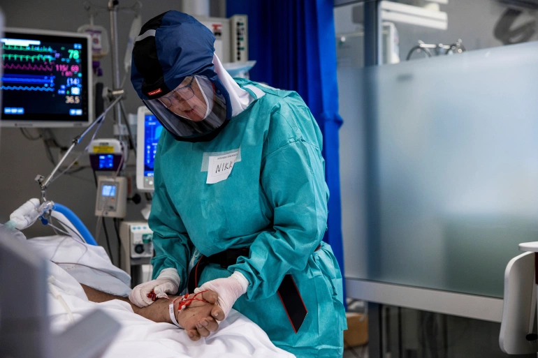 A COVID-19 patient is treated in the intensive care unit at Oslo University Hospital [File: NTB/Jil Yngland via Reuters]